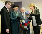 The President and his wife Sabina were presented with products made by the Sheep Thrills knitting group which meets weekly in the centre. They are pictured with the Rector of Holy Trinity, the Revd Niall Sloane and Sheep Thrills coordinator, Joan Millar, at the official opening of the refurbished centre.